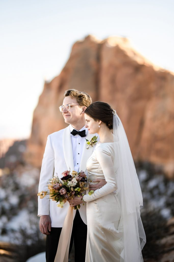 Bride and groom at Mesa Arch