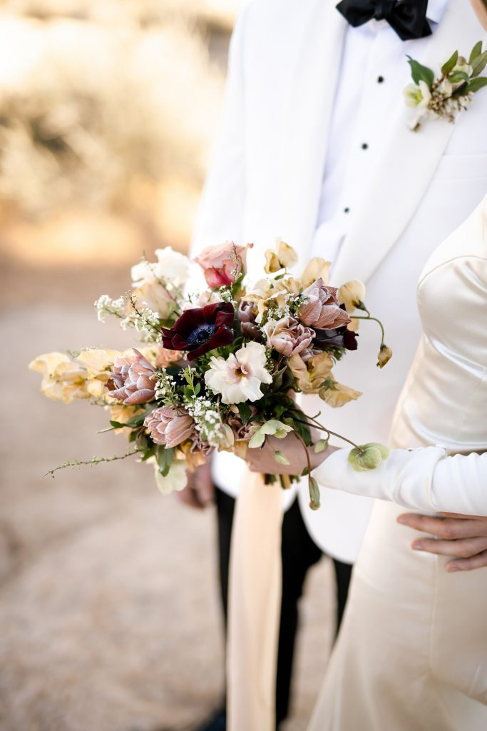 Colorful wedding bouquet at mesa arch