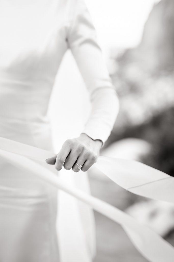Bride touching silk ribbon