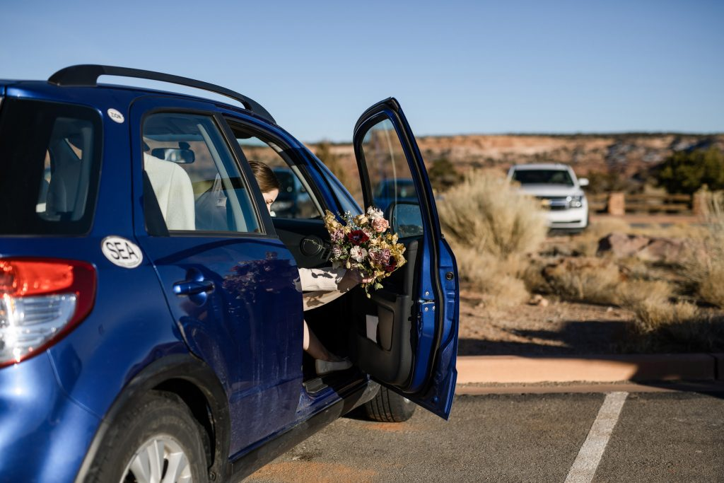 Bride getting out of car door