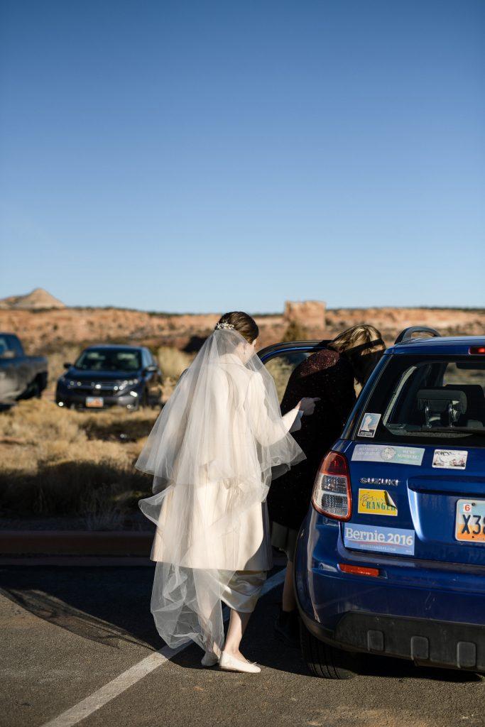 Bride getting into car