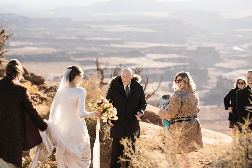 Bride walking into Green River Overlook wedding