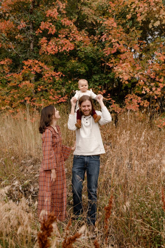Family playing in dried grass