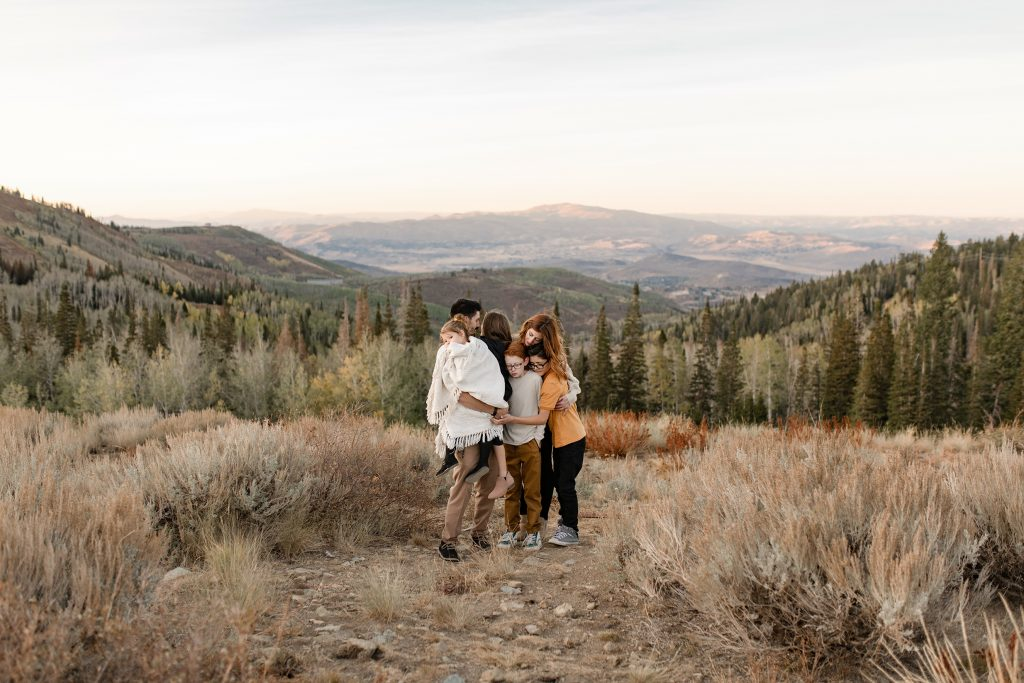 Family hugging in Park City