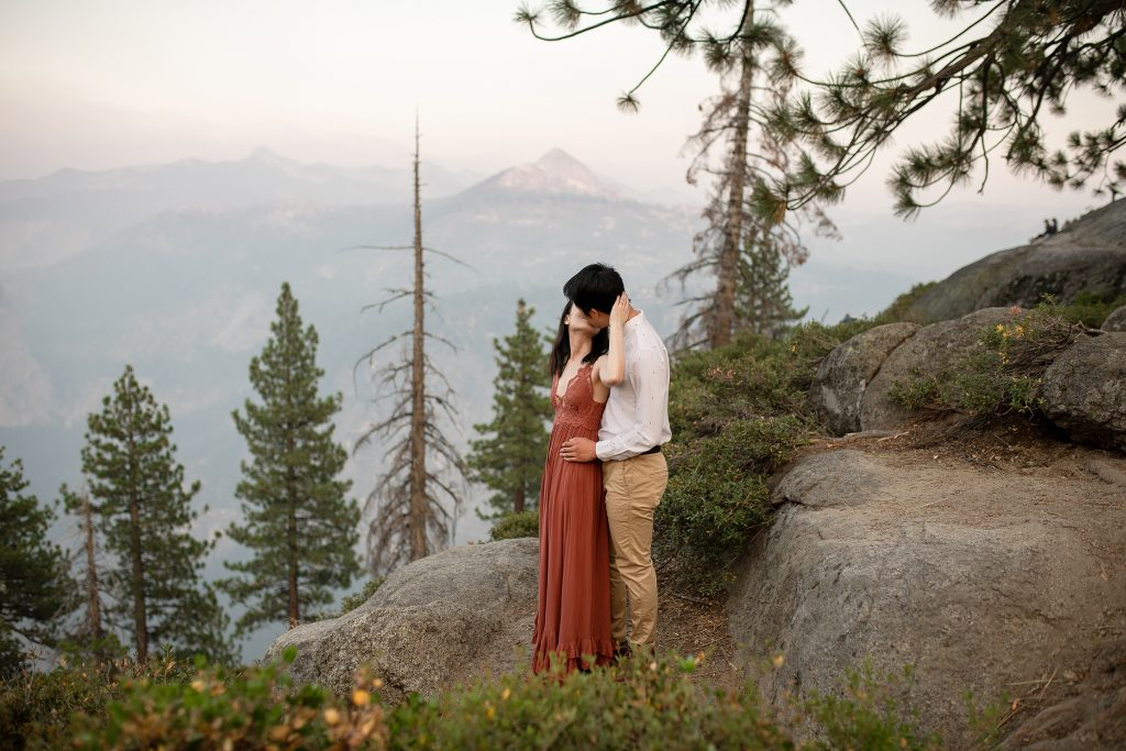 Engaged couple at Glacier Point in Yosemite National Park